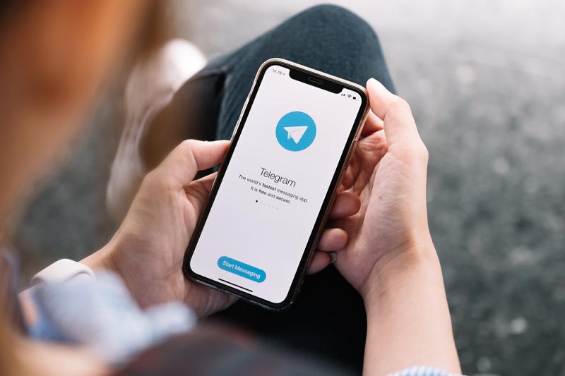 Man with Telegram on phone