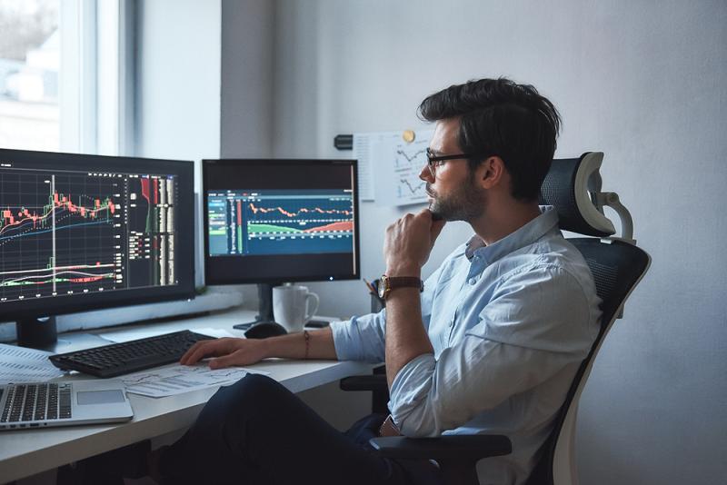 Trader at screens
